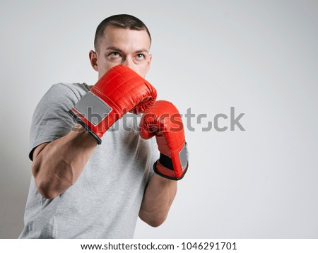 Stock Photo man in red Boxing gloves on white background
