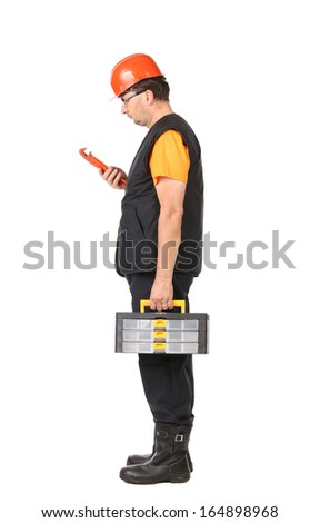 Man in red hard hat looking at wrench. Isolated on a white background.