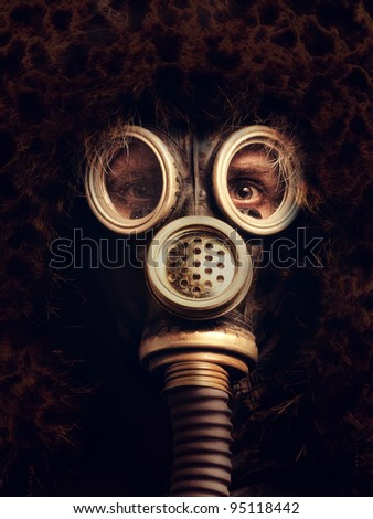 Man in respirator in the darkness
