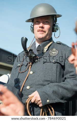 Man in Royal Observer Corps uniform and vintage radio communications equipment