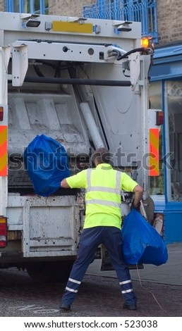 Man in safety clothing collecting plastic waste sacks