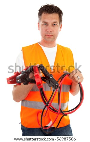 man in safety vest holding car jumper cables over white background