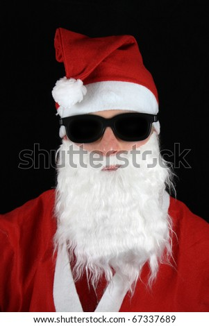 man in santa suit wearing dark sun glasses