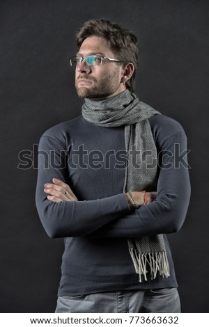 man in scarf and sweater with...
