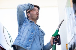 man in shock with gas price