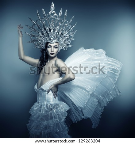 man in silver crown and white dress