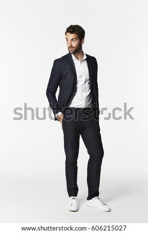 Man in smart suit looking away in studio