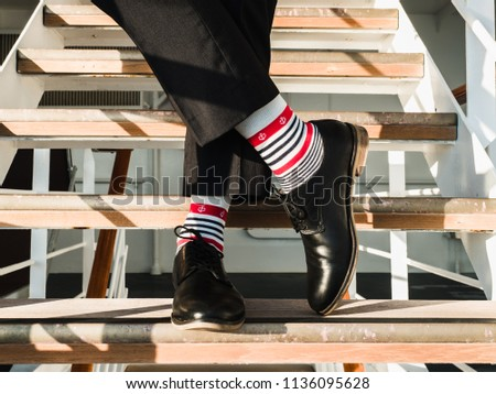 man in stylish  black shoes ...