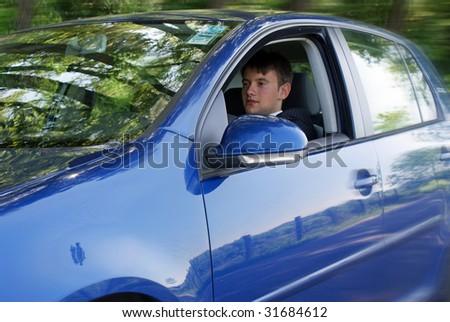 Man in suit driving modern car