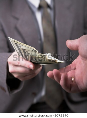 man in suit giving 1000 dollars another man