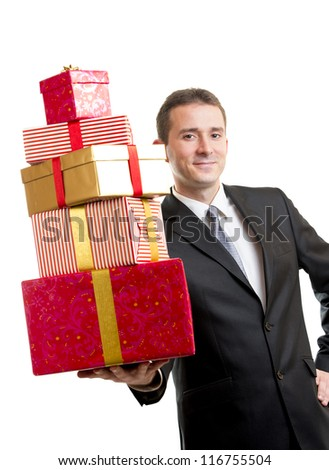 Man in suit holding a stack of presents