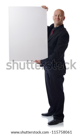 man in suit holding large card advert