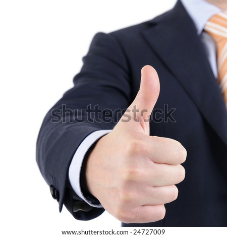 Man in suit is giving the thumb's up sign.