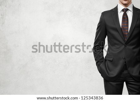 man in suit on a light concrete wall background ストックフォト ©
