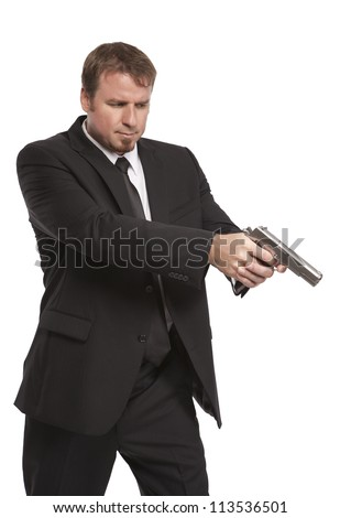 Man in suit points his weapon
