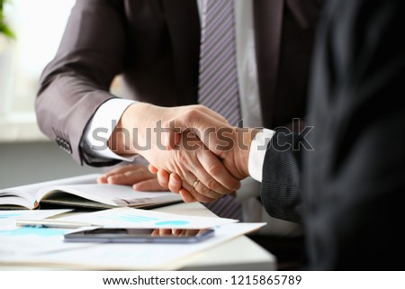 Man in suit shake hand as hello in office closeup. Friend welcome mediation offer positive introduction greet or thanks gesture summit participate approval motivation strike arm bargain concept
