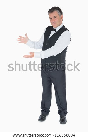 Man in suit showing us something against the white background
