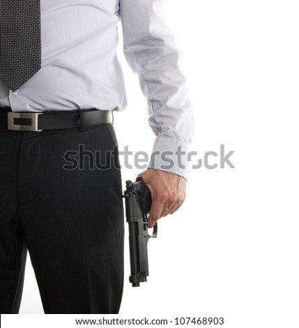Man in suit with a gun in his hand isolated on a white background - stock photo