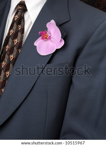 Man in suit with orchid