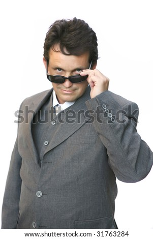 man in suit with sunglasses over white background