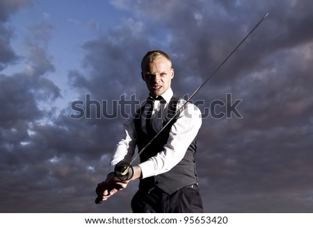 Man in suit with sword