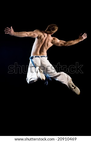 Man in the air from behind. Jump from explosion pose
