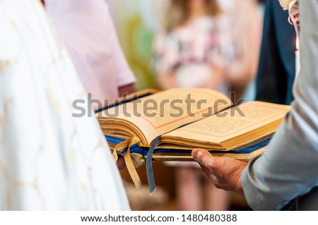 Man in the church holding Gospel in the hand #1480480388
