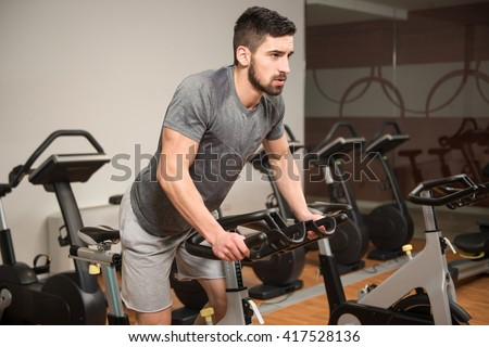 Man In The Gym - Exercising His Legs Doing Cardio Training On Bicycle