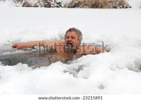 man in the ice-hole with a pipe - stock photo