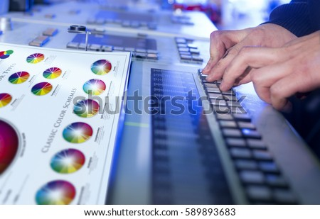 Man in the process of offset printing and color correction with changed original printed sheet.