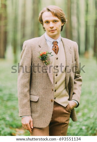 man in the vintage suit  with...