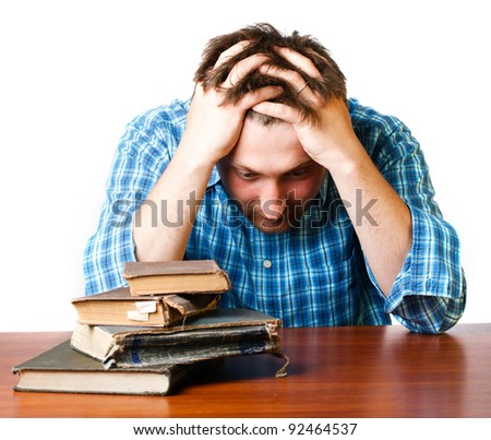man in thinking near a pile of old books on a white background