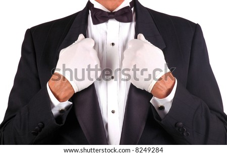 Man in Tuxedo Holding Lapels in Both Hands isolated over white