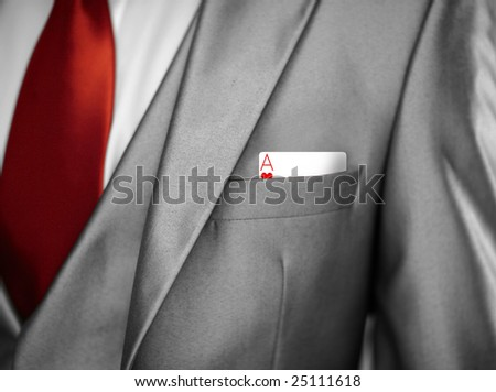 man in tuxedo jacket with an ace in his pocket