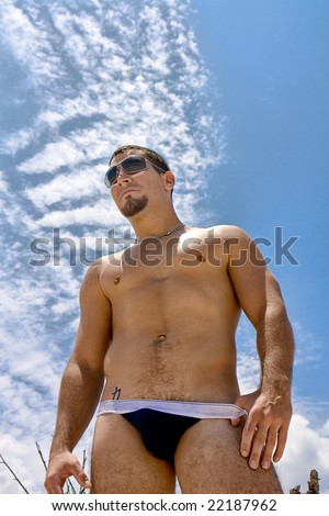 Man in underwear oposite blue sky