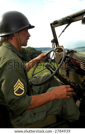 Man in uniform driving jeep