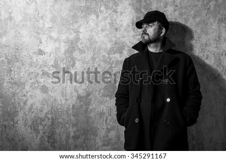 man in vintage cap and coat...
