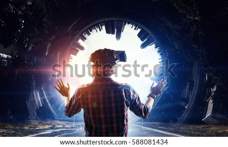 Stock Photo Man in virtual helmet    . Mixed media