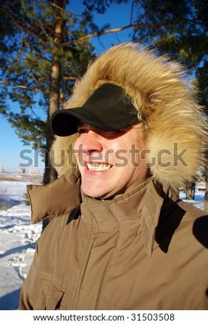 man in warm jacket in winter