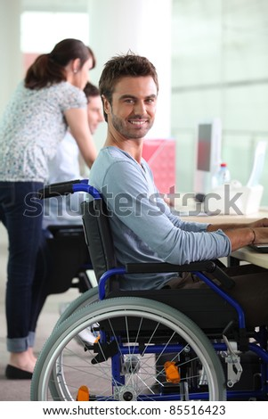 Man in wheelchair at work