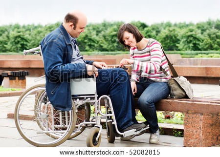 Man in wheelchair with his girlfriend