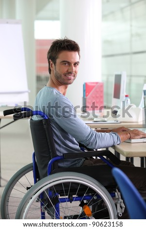 Man in wheelchair working at computer