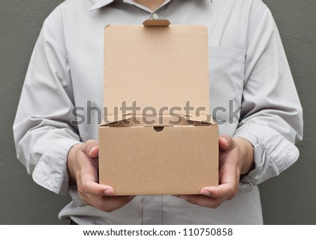 Man in white shirt carry recycle paper box hand under