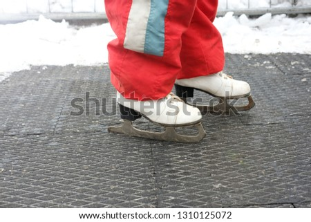 man in white skates and red ski trousers for ice skating and figure skating in winter, sports and recreation  #1310125072