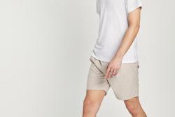 Man in white tee beige shorts mockup