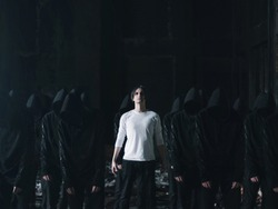 man in white with followers in black cult concept
