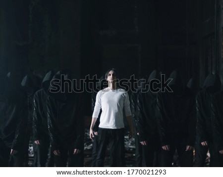 man in white with followers in black cult concept Stock photo ©
