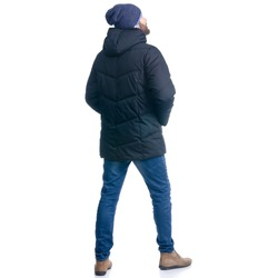 Man in winter jacket and warm hat standing looking on white background isolation, rear view