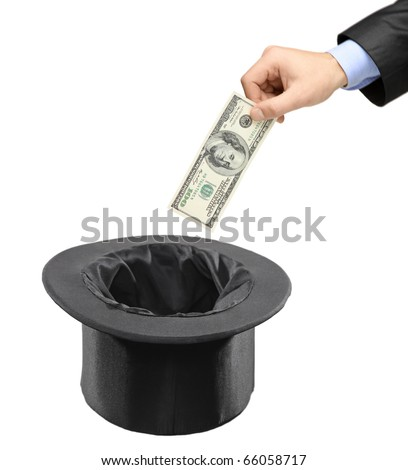 Man inserting a dollar into a black hat isolated against white background