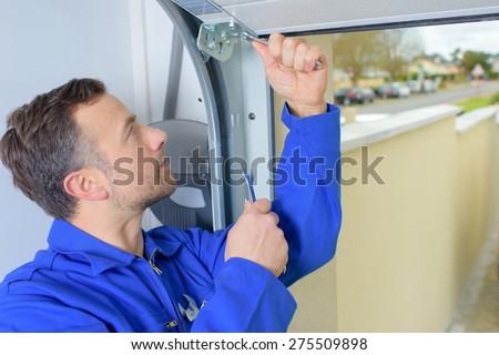 Man installing a garage door